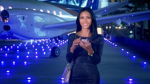Futuristic network concept. Technology. 5g or 4g internet speed. charming asian girl, ladyboy is using her smart phone while standing at the airport.