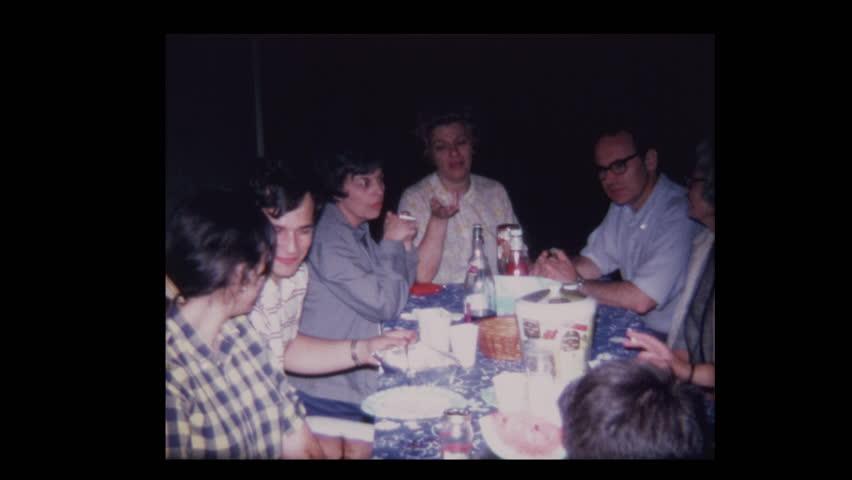 N. Belmore, New York, USA- 1968: Family nighttime dinner outside in the dark  | Shutterstock HD Video #1024306253