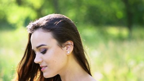 3d0ccf86114d Side View Of Beautiful Smiling Girl. Close Up Of A Face Of A Pretty Brunette