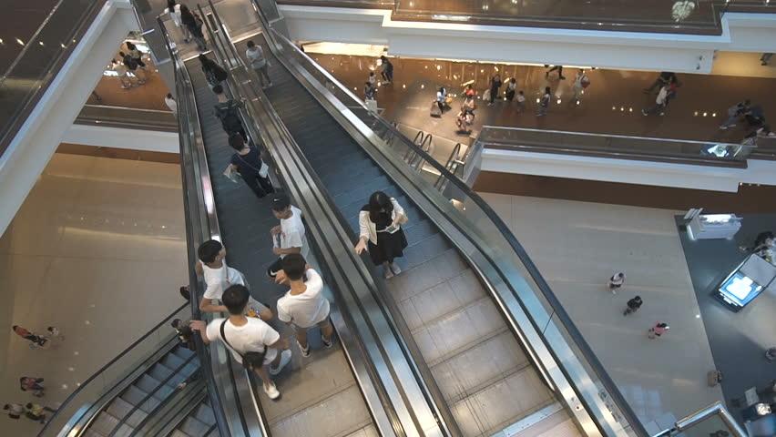 Escalators modern shopping mall timelapse. Consumption concept time lapse