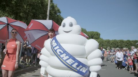 Le Mans, France - June 16, 2018 : White inflatable man Bibendum, more commonly known as the Michelin Man on a public pilots parade in Le Mans, France.