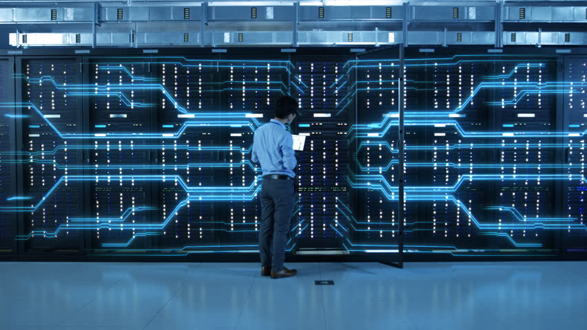 IT Specialist Standing In front of Server Racks with Laptop, He Activates Data Center with a Touch Gesture. Animated Concept of Digitalization of Information: Network of Lines Spreading Symmetrically