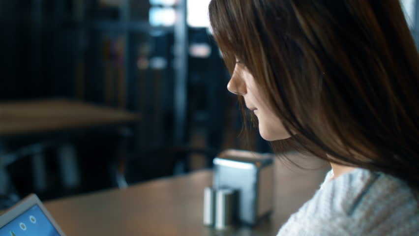 Young girl work on tablet in cafe or office in slow motion. 4K close up footage. | Shutterstock HD Video #1024564043