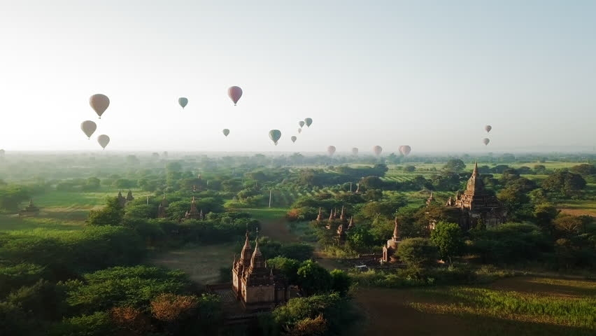 Aerial: Hot Air Balloons Flying Over the Temples of Old Bagan
