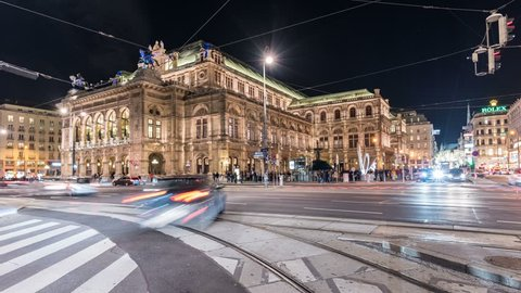 VIENNA WIEN - AUSTRIA - JANUARY 2019: Timelapse of Vienna Wien Opera House at night with traffic