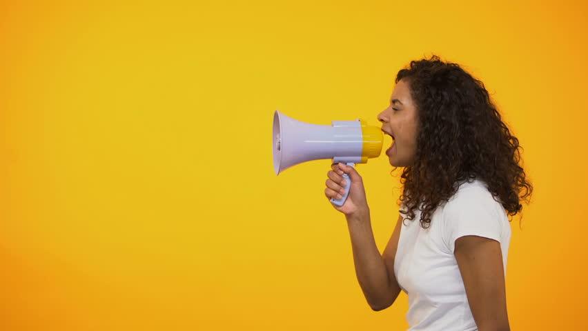 African-American woman with megaphone announcing sensation news, shop discounts | Shutterstock HD Video #1024661963