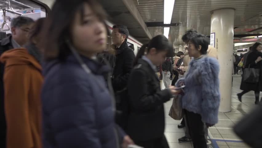 TOKYO, JAPAN - FEBRUARY 5, 2019: Tokyo Metro Stop with Many People. Their Are Waiting Train | Shutterstock HD Video #1024795793