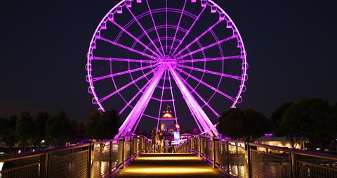 Montreal, Quebec, Canada - August 22, 2018: La Grande Roue de Montréal is a tourist Ferris wheel in the Port of Old Montreal across from the Old Town and Bonsecours Market