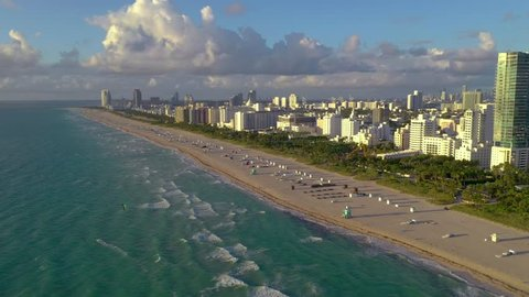 MIAMI, FLORIDA, USA - JANUARY 2019: Aerial drone panorama view flight over South Miami and Mid-Beach ocean coastline. Miami Beach Boardwalk from above at sunny day.