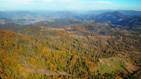 aerial drone shot over the mountain landscape summer season sunny day