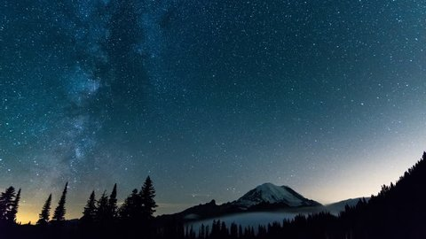 the milky way moving above the rainier mountain, WA, US. nighttime time lapse.