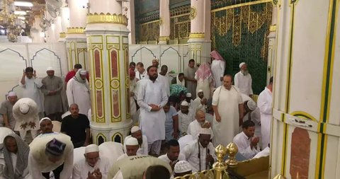 MADINAH, SAUDI ARABIA – September 2016: Muslim pilgrims visiting the beautiful Nabawi Mosque, the Prophet mosque which has great architecture during hajj  season