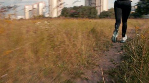Close Up Woman Running Foot And Leg Shot.Woman Run.Woman Running.Beautiful Girl Running On Green Grass Field.Close Up Girl Running At Sunrise.Woman Jogging.Close Up Girl Run.Female Runs.Female Jogging
