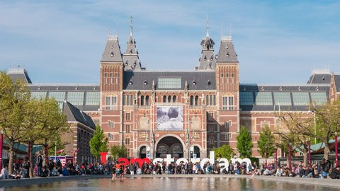 AMSTERDAM, NETHERLANDS - MAY 6, 2017: Amsterdam Netherlands time lapse 4K, timelapse at Rijksmuseum (Dutch National Museum) and I Amsterdam Sign