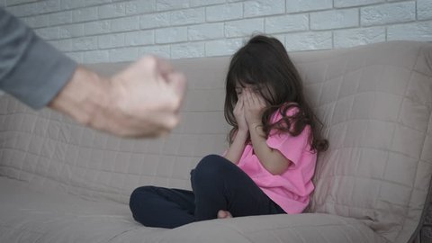 Domestic violence. Child abuse. The father threatens to beat the child.