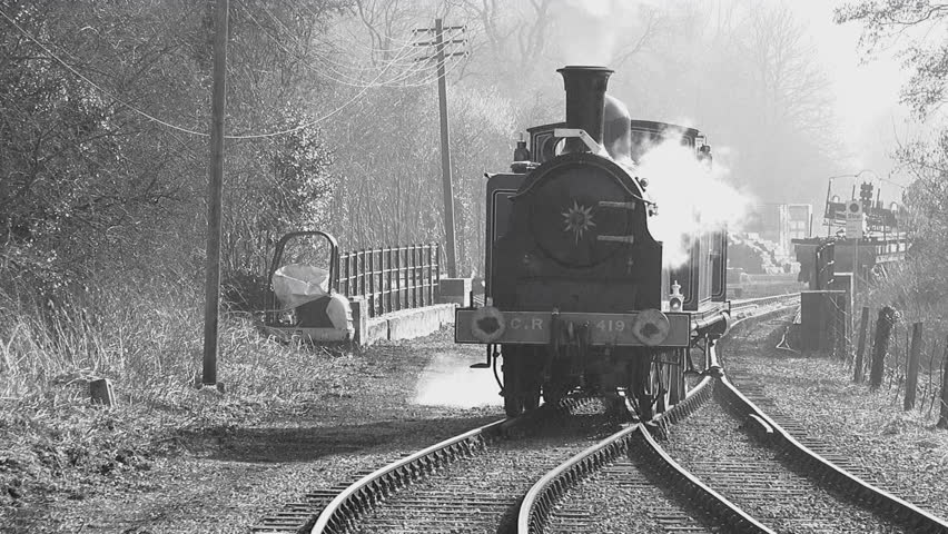 Old style black and white footage of steam train in England UK 4K