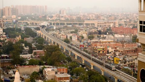 Day to night timelapse showing the delhi cityscape. Shows buildings with lights, traffic, newly inaugrated metro extension and the horizon in Delhi. A beautiful look at Delhi, Noida, jaipur, lucknow