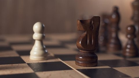 Chess game. White pawn beats black knight. Brain challenge, success, personal growth concept