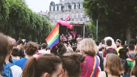 STRASBOURG, FRANCE - CIRCA 2018: Newsworthy footage of large crowd of people celebrating dancing near gay truck with gay and lesbians queers at annual FestiGays pride