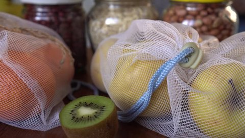 Zero waste home. Eco Shopping. Mason jars and reusable grocery bags on the kitchen