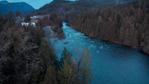 A pristine rushing river near Stave Lake, BC at dusk.