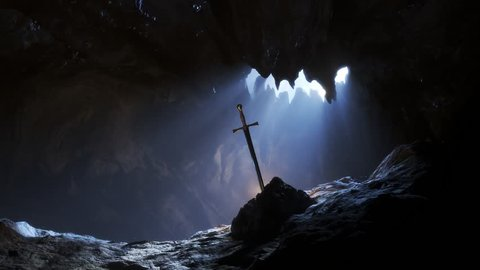 Excalibur the famous, legendary, steel sword of King Arthur. Sword in the stone with light rays and dust specs in the dark cave. Dark, mysterious atmospheric animation. 4k