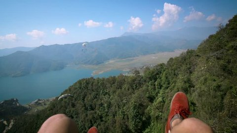 Hanging Legs During Paragliding in Pokhara, Nepal. Adventure and Adrenaline Sport. Tourist Attraction in Himalaya Mountains, Pokhara Lake. Slow Motion.