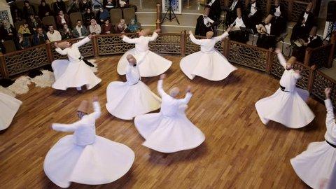 Konya, Turkey - October 20, 2018: Semazen or Whirling Dervishes at Mevlana Culture Center in Konya, Turkey.