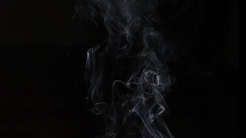 White Steam Rises from the Pan. White Steam rises from a large pot that is behind the scenes. Shot on Black background. Filmed at a speed of 180fps. hd