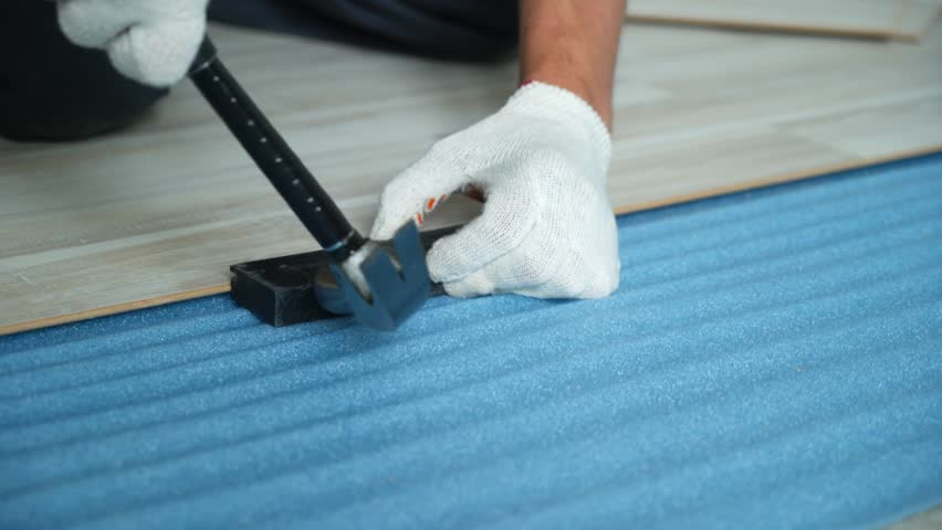 Builder renovating apartment. Repair of the apartment, laying laminate flooring. Construction. | Shutterstock HD Video #1025655923