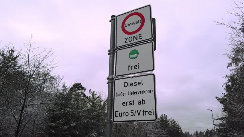Driving ban of diesel cars in germany. The Euro V declaration for emission standards is coming. A cold winter day in germany with the prohibition street signs at a road nearby stuttgart, germany. | Shutterstock HD Video #1025712053
