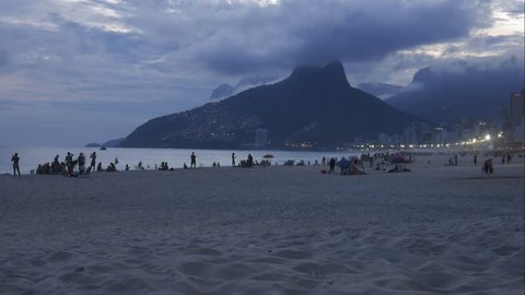 4K timelapse view of Ipanema beach with Morro Dois Irmaos (Two Brothers) and favela Vidigal in the background, Rio de Janeiro, Brazil