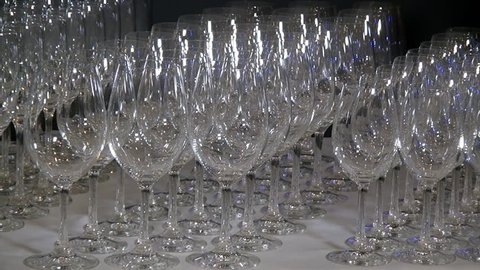 Crystal clear glass goblets shine on the banquet table. Static shooting frame wine glasses.