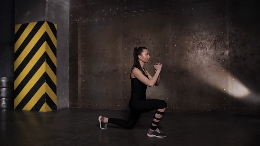Athletic Beautiful Woman doing exercises in the gym, Gym Training Routine. | Shutterstock HD Video #1025792663