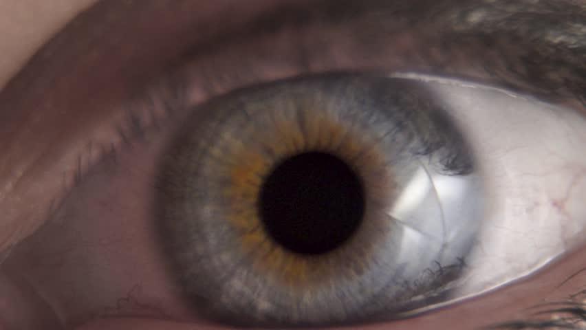 Macro closeup of a blue green human eye in slow motion #1025803913