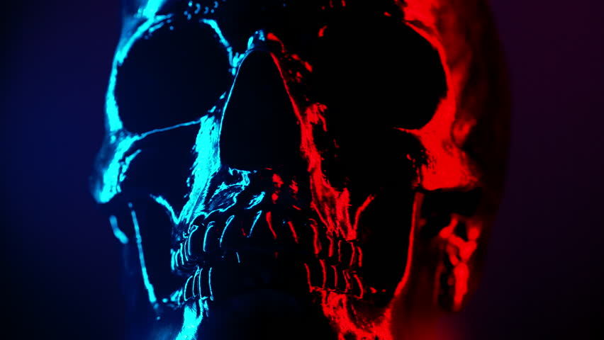 Ancient human skull head rotating close-up. Neon turquoise and red light. Spooky and sinister. Glamour, disco, halloween concept. | Shutterstock HD Video #1025811713