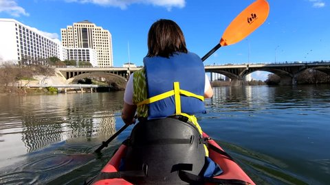 16 JAN 2019 - AUSTIN, TEXAS: Austin Texas city wife in kayak lake river POV. Vacation recreation and sightseeing. Lady Bird Lake, Town Lake is a river reservoir on Colorado River in Austin, Texas.