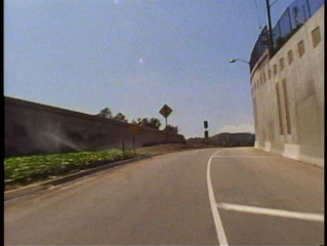 LOS ANGELES, CALIFORNIA, 1994, POV from car entering Hollywood Freeway | Shutterstock HD Video #1025883143