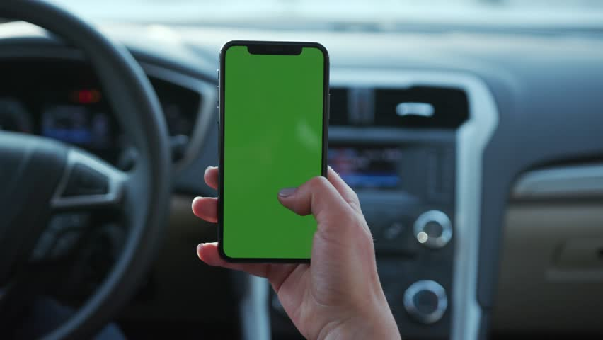Paris, France - April 5, 2018: Hands holding use phone with vertical green screen in cargirl transport touchscreen blank connection internet mobile communication smartphone close up slow motion   Shutterstock HD Video #1025899313