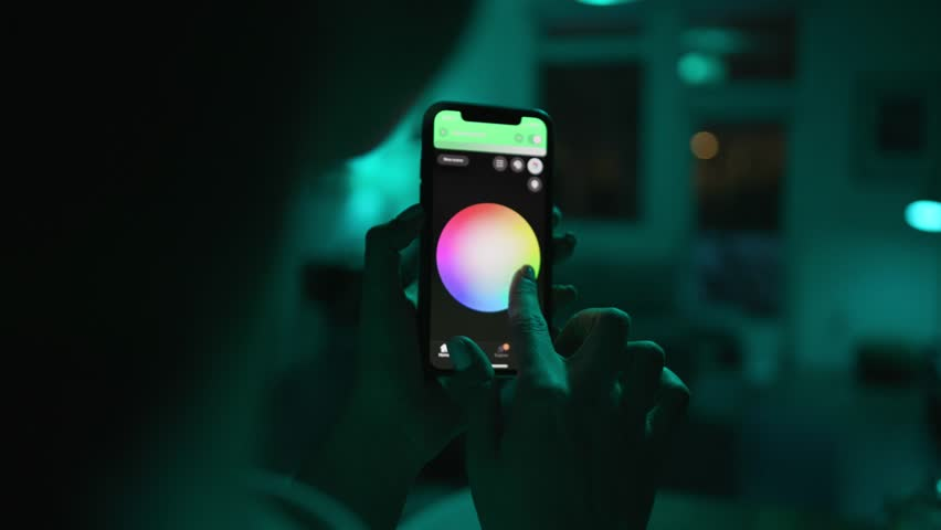 Controlling lights with an app in smart home / Smart house features / Changing mood/color of the lights  | Shutterstock HD Video #1025962763
