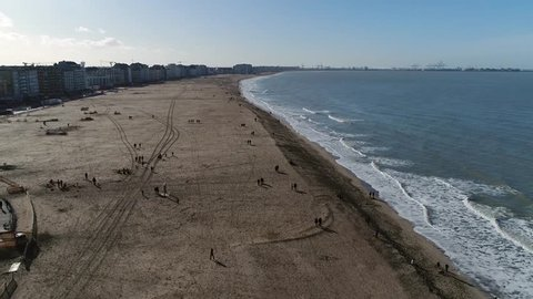 Aerial view of beach of Knokke-Heist is municipality in the Belgian province of West Flanders and is located along the North Sea in a polder area and is best-known and most affluent seaside resort 4k