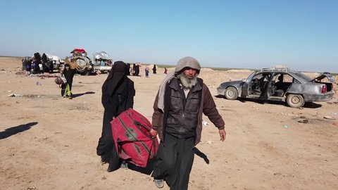 Syria - March 15, 2019: ISIS victims boarding bus in desert 2