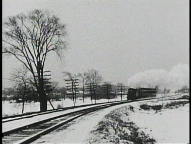 NEBRASKA PRAIRIES, 1905, Archival footage of steam train passing in winter