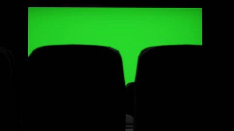 Cinema interior of movie theatre with blank movie theater screen with green screen and empty seats. Movie entertainment concept.
