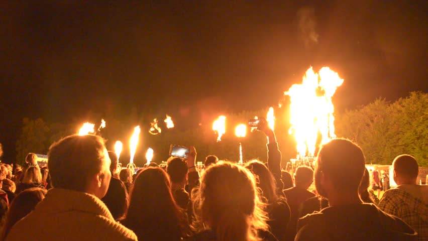 Bousov castle Czech Rep August 19th 2017 People with cellphones wath the public fire show of hot air balloons lined up in a row and firing together with song. Editorial. | Shutterstock HD Video #1026037793