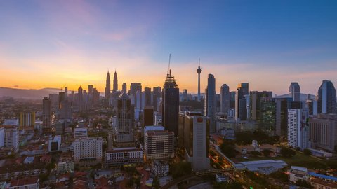 Time lapse: Kuala Lumpur city aerial view during dawn overlooking the city skyline in Federal Territory, Malaysia.