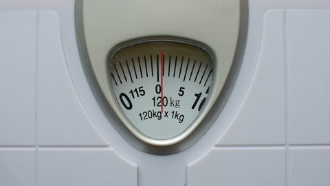 Close up body weight scales for measure weight loss.Weighing scale on wood background