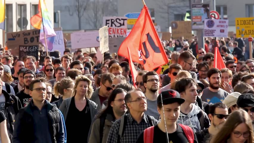"Erfurt, Germany – Mar. 23,2019: walking german sign slogan protest march demonstration against new copyright law ""Artikel 13"". Protester got called bots by CDU. More than 100.000 protesters in Germany 