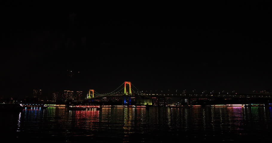 Fireworks near Rainbow bridge at the beach. Koutou-ku Odaiba Tokyo Japan - 12.08.2018 : It s a city location in Tokyo. camera : Canon EOS 5D mark4   Shutterstock HD Video #1026198413