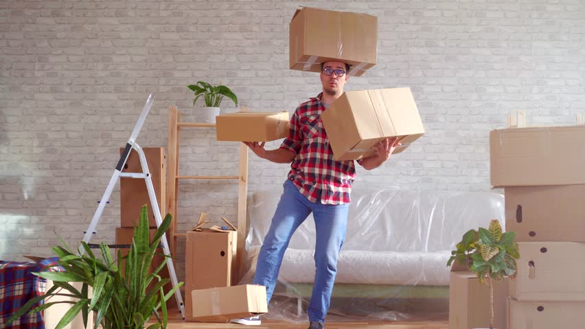 Man in glasses and shirt with boxes on his head, hands and feet | Shutterstock HD Video #1026227363